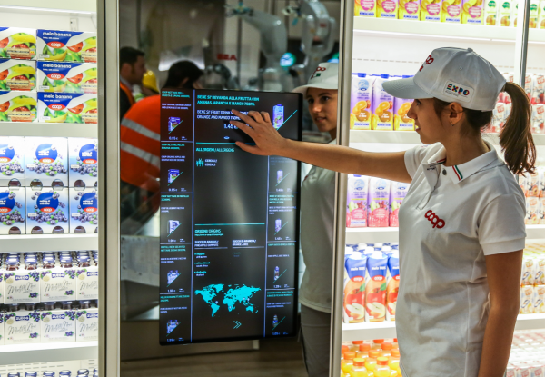 """Coop's award-winning """"supermarket of the future"""" design replaces the typical grocery store's rows of towering shelves with a spacious layout with easy-to-reach, tilted displays and informative screens suspended at eye level, reports Susanna Ray in a Microsoft blog post."""